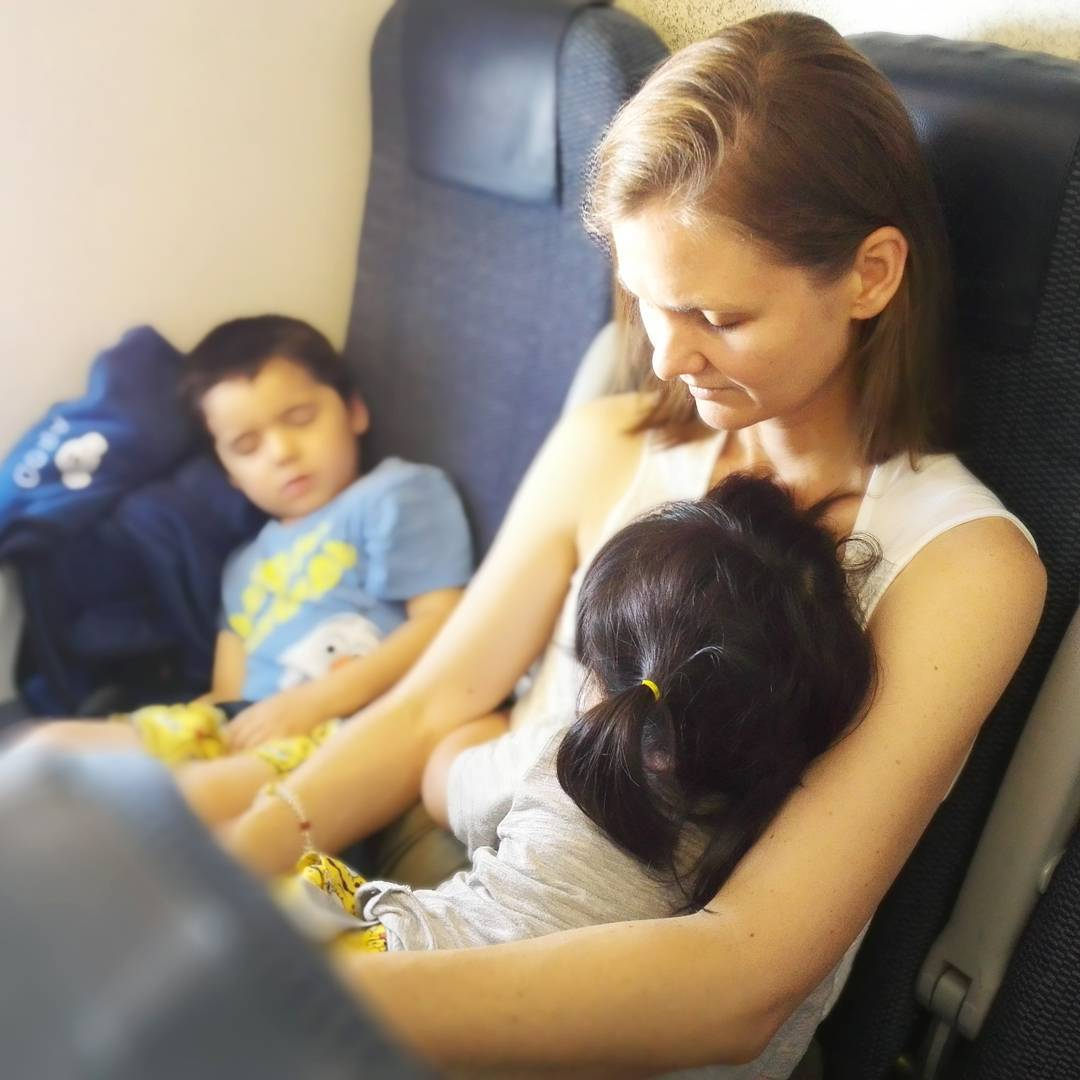 "Travel tip! One if my most popular Youtube videos is ""How to survive a 9 hour flight with a toddler"". The biggest surprise for me when I first caught a plane with my kids is that they will NEVER sleep in the airport, even if it is their usual nap time. There is just too much activity and noise and bright lights. So what happens? They collapse as soon as the plane takes off! And me too. ;) So if you're catching a flight soon with your toddler, just remember to relax and enjoy the trip, as they will 99% of the time sleep well once they're on the plane! This is a photo from our recent trip to Hokkaido ;)"