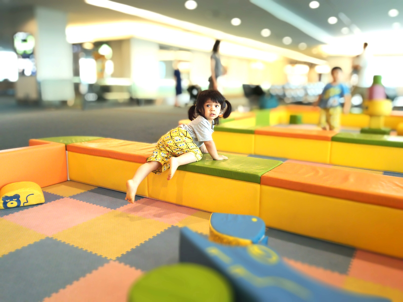 My daughter having fun crawling and rolling around in the play space