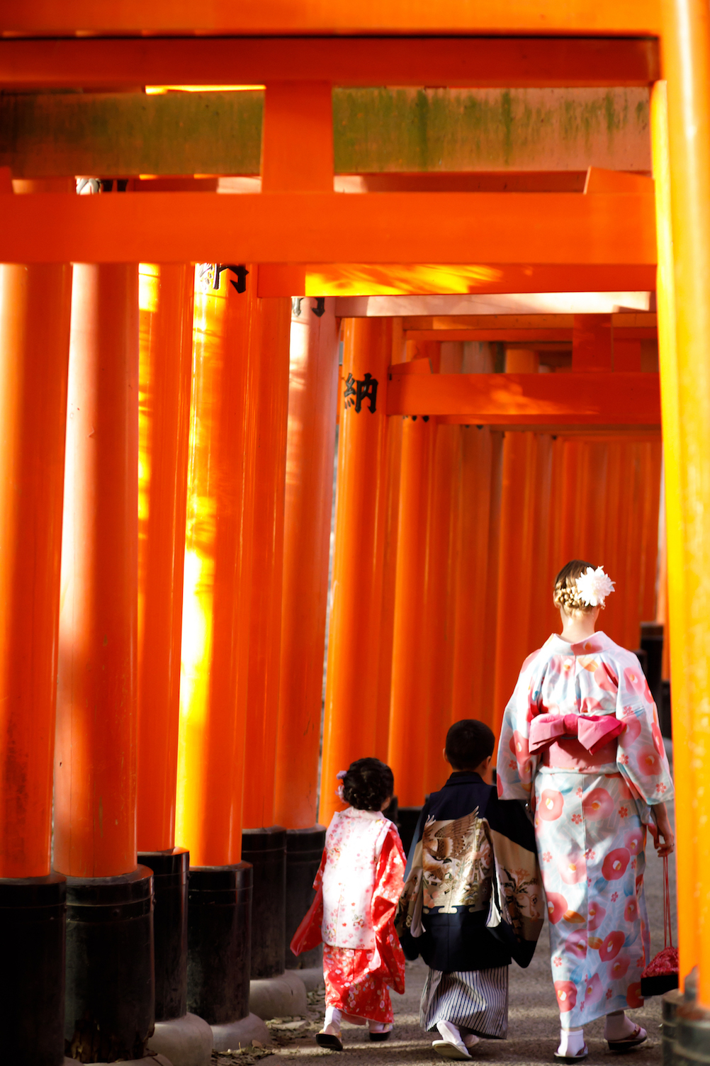 Kyoto Guide Fushimi Inari with kids walking under torii