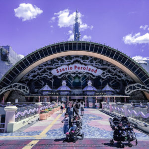 Sanrio Puroland Japan entrance with a stroller and kids